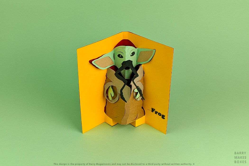 Australian Packaging Design, Product Design Special Unique Present Baby Yoda all I want for Christmas is frog gift card pop up Paper craft Art work Sculpture Cardboard frame Paper kraft craft character on green by Barry Makes Boxes, Barry Magazinovic